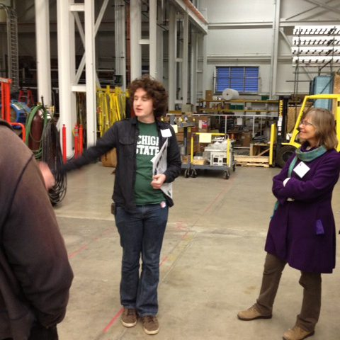 Tour group of adults at MSU's National Super Conducting Laboratory